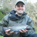 Scott Smith with his first fish when fishing in Scotland using the fly a superb grayling